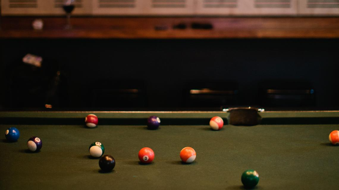 Close up of a pool table with coloured balls